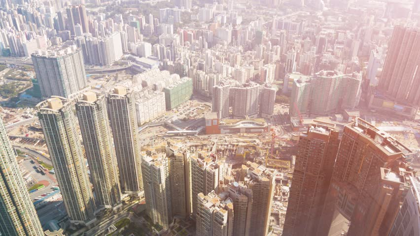 Overlooking shot of a major highway interchange in crowded. downtown Hong Kong. with many highrise buildings and lots of traffic. | Shutterstock HD Video #14256248