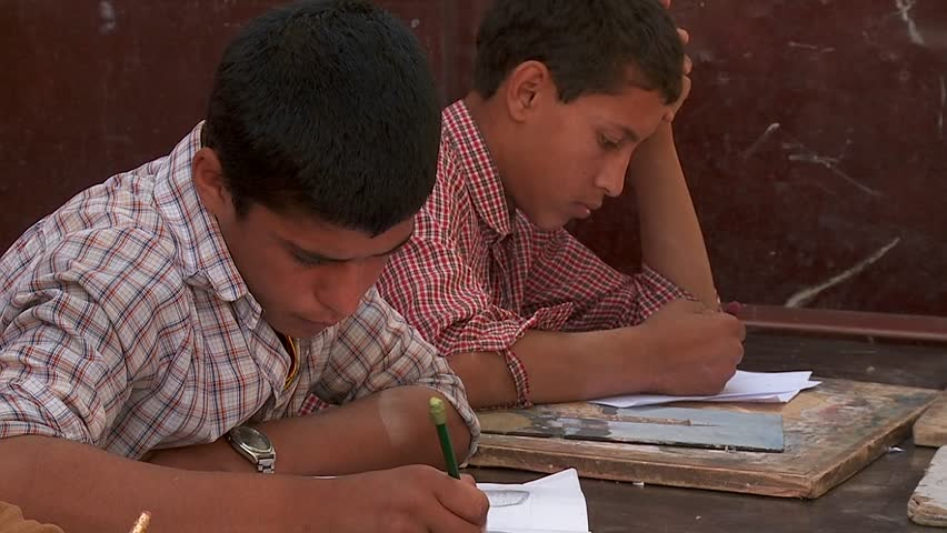KABUL, AFGHANISTAN - CIRCA 2009: Boys study in a school circa 2009 in Kabul, Afghanistan. Afghanistan is an impoverished and least developed country, one of the world's poorest.   - SD stock footage clip