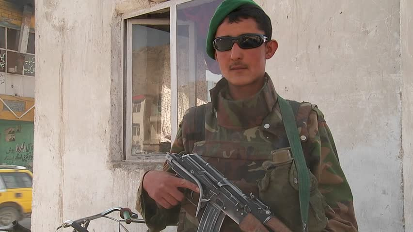 KABUL, AFGHANISTAN - CIRCA 2009: An Afghan National Army soldier fulfills a peacekeeping role in downtown circa 2009 in Kabul, Afghanistan. - SD stock footage clip