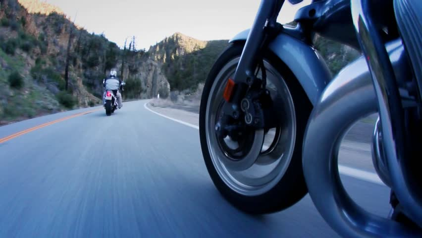 Two motorcyclists on mountain highway (low angle) - HD stock video clip
