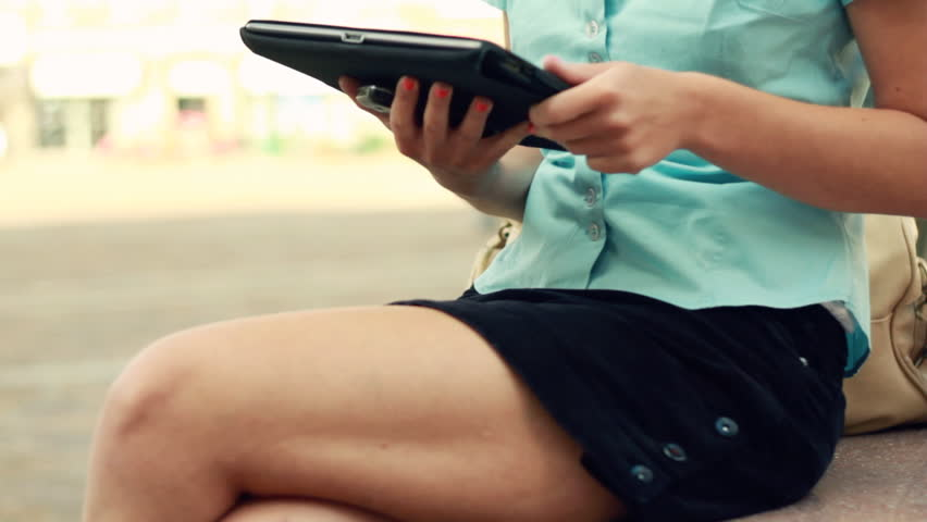 Woman hands with tablet computer outdoors, camera stabilizer shot - HD stock footage clip