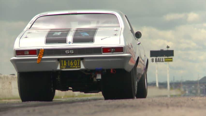 CANADA - CIRCA 2011:  a silver Nova drag racing circa 2011 in Canada - HD stock footage clip