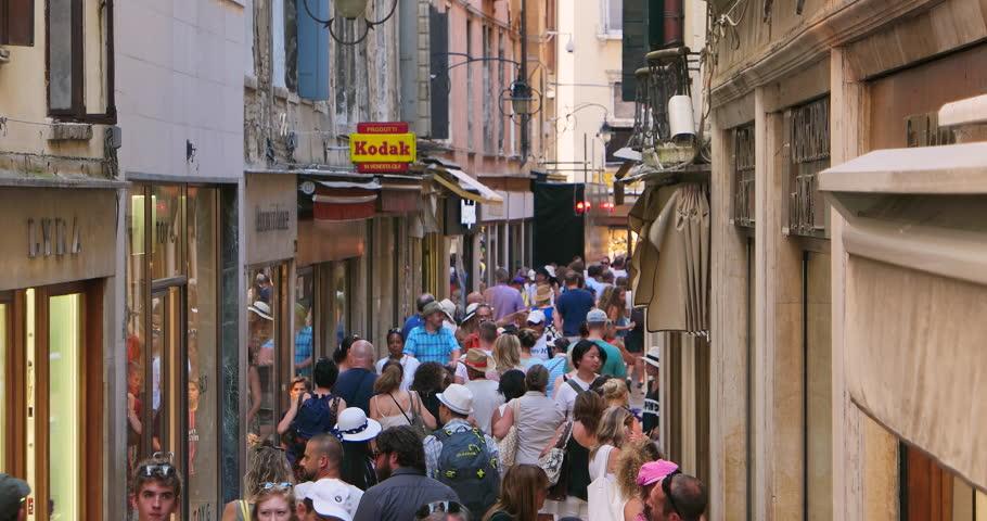 VENEZIA ITALIA 10 JUL 2015: Crowded narrow street in Venice, Italy. Italian narrow street. Narrow street Europe. Narrow town street. Medieval narrow street. Venice narrow street. Travel narrow street
