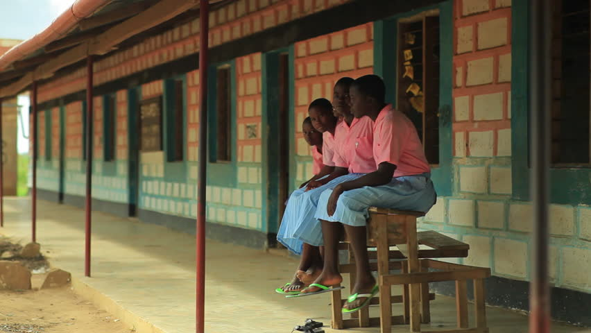 KENYA, AFRICA - CIRCA 2011: Children sitting on a bench in a village in Kenya two hours north of Africa city Mombassa