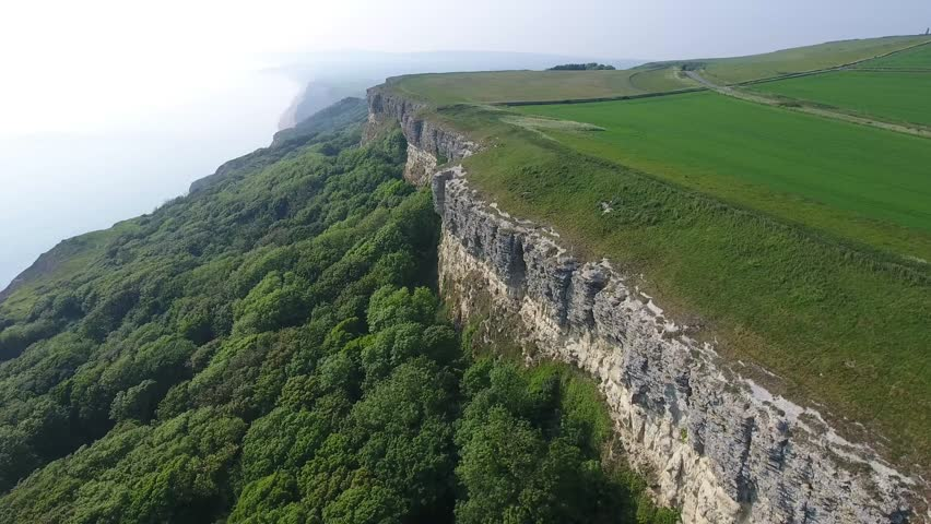 England Isle of Wight Aerial Cliff View Blackgang Niton Undercliff Cliff Grass with Forest on South Coast