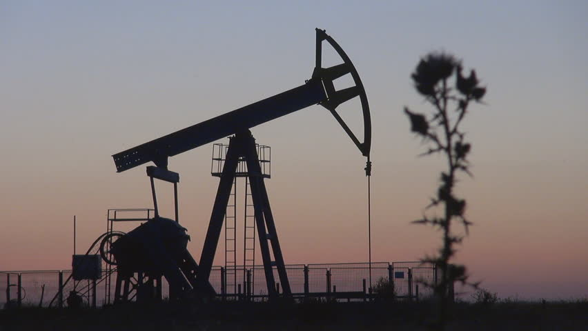 Oil Pump working at sunset - HD stock footage clip