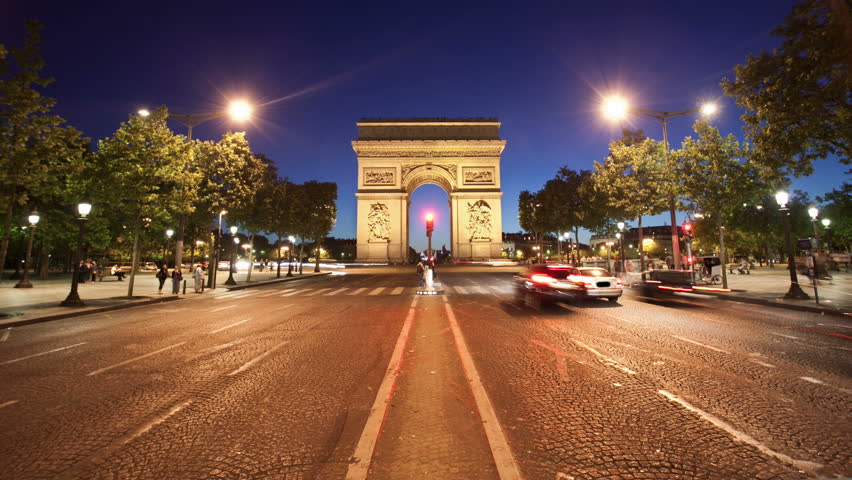 PARIS - JUNE 2011: Nighttime timelapse with the Arc de Triomphe as traffic passes by