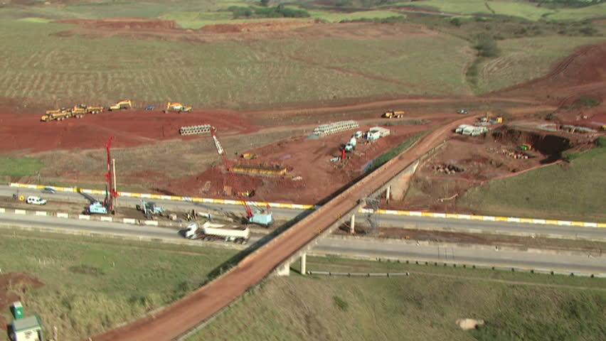 Aerial of bridge under construction - HD stock footage clip