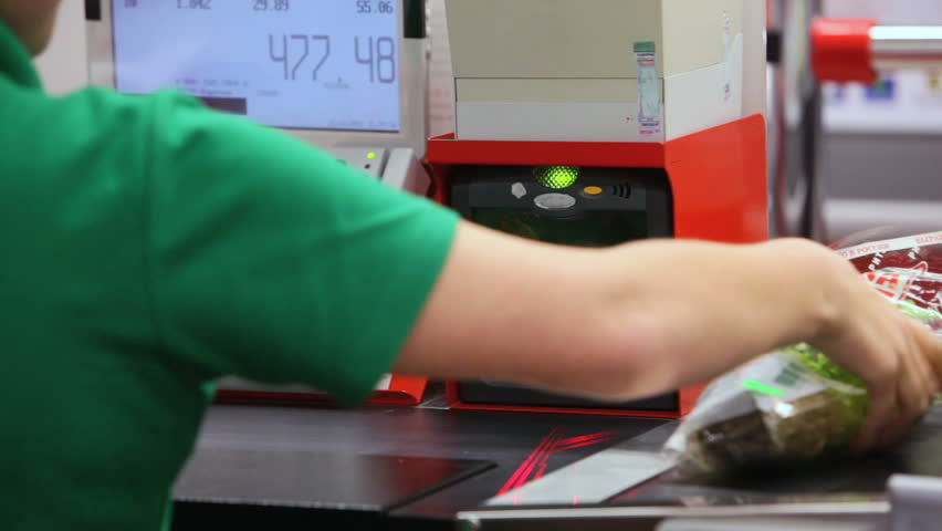 Customer paying for groceries at checkout counter - HD stock video clip
