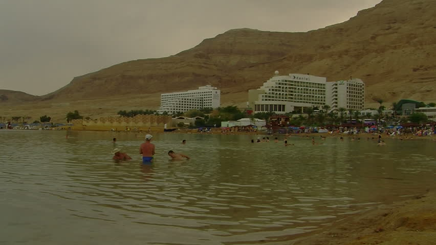 DEAD SEA, ISRAEL - CIRCA MAY 2010: People floating in the Dead Sea - HD stock video clip