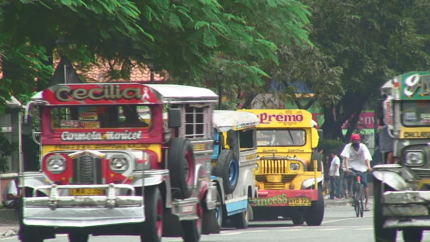 MANILA,  PHILIPPINES - CIRCA 2011: Colorful buses in downtown Manila, Philippines - HD stock footage clip