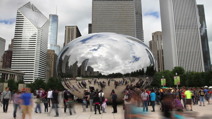 CHICAGO - SEPTEMBER 5, 2011 - Time lapse, a crowd of tourists at the Cloud Gate Sculpture in Millennium Park - HD stock footage clip