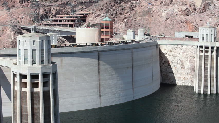 Hoover Dam hydro electric tourist traffic crossing to lookout view areas fast motion timelapse. View from Lake Mead across mountain peaks and valley supporting the concrete structure.  - HD stock video clip