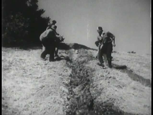 Workers shaping an irrigation canal