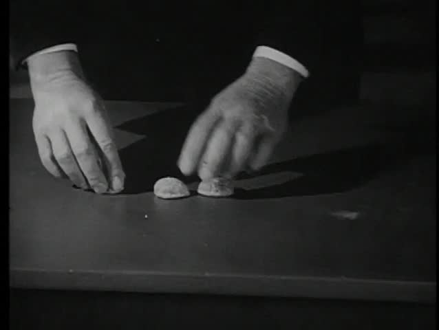 Close-up of hands playing game with walnut shells