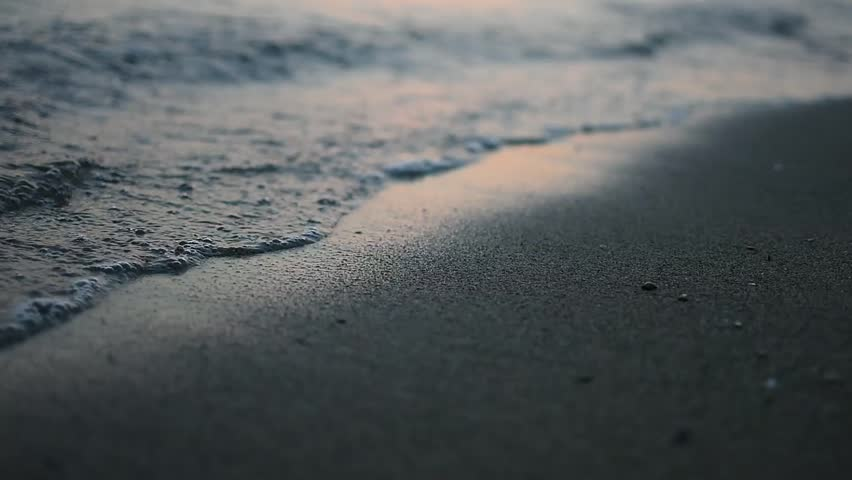 Nirvana on the Beach - Peaceful Idyllic Scene of a Golden Sunset Over the Sea,  Waves Slowly Splashing on the Sand. Closeup of Calm Sea at Dusk. Sun Reflection in Sea Water. Nature Background.