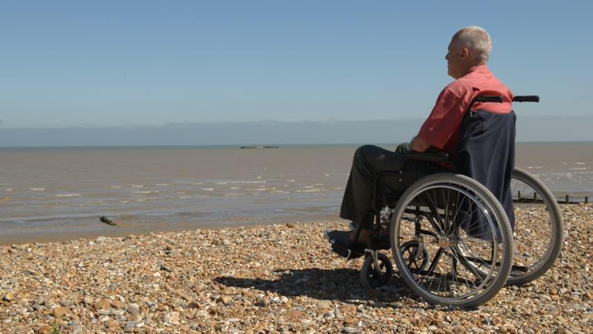 man in wheel chair க்கான பட முடிவு