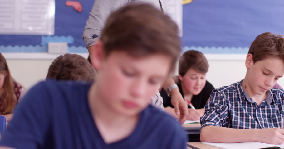 4k, A young teacher spending some one-on-one time with his students during class. Slow motion. | Shutterstock HD Video #18843908