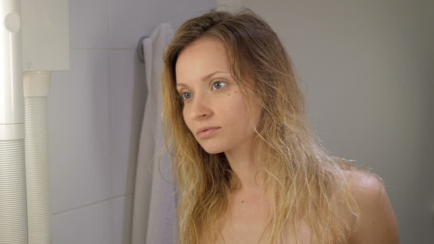 Young girl after shower drying long blond hair in bathroom of hotel | Shutterstock HD Video #18902705