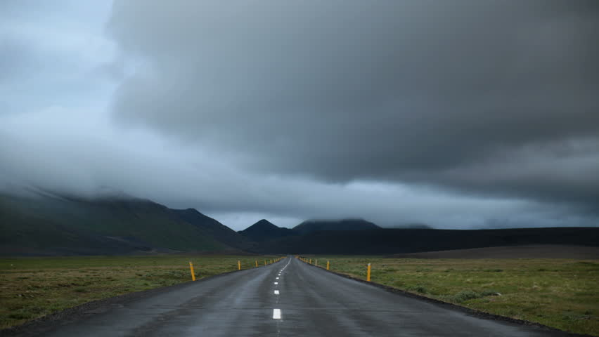 Storm clouds passing over mountain road Icelandic highlands 4k | Shutterstock HD Video #18910832