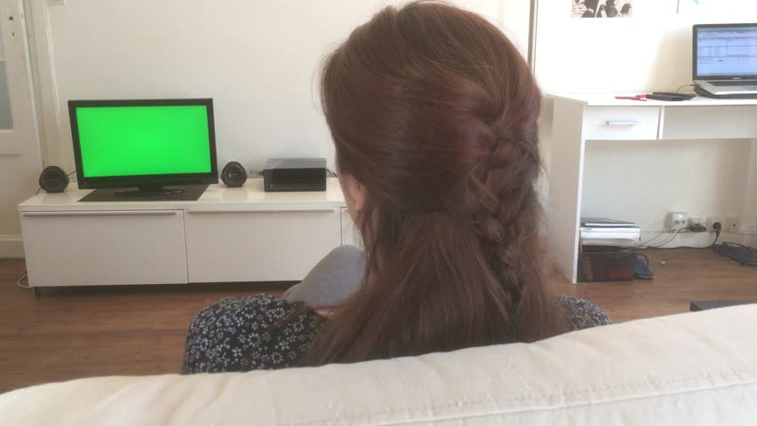 Dolly Shot, Relaxed Young Woman Watches TV at Home, Green Screen. Charming young woman watching green screen television at home. Ungraded 4k | Shutterstock HD Video #18931523