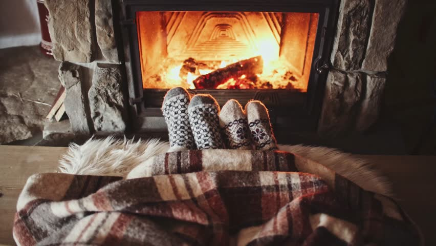 Couple Feet in Wool Socks by the Cozy Fireplace, 4K. Man and Woman sitting under the blanket, relax by warm fire and warming up their feet. Close up. Winter and Christmas holidays concept.  | Shutterstock HD Video #18943925