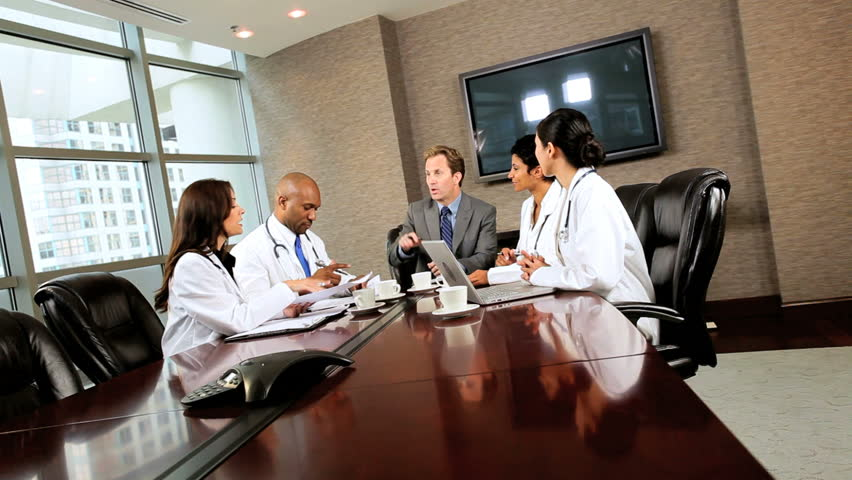 Multi ethnic medical executives meeting financial advisor - HD stock footage clip