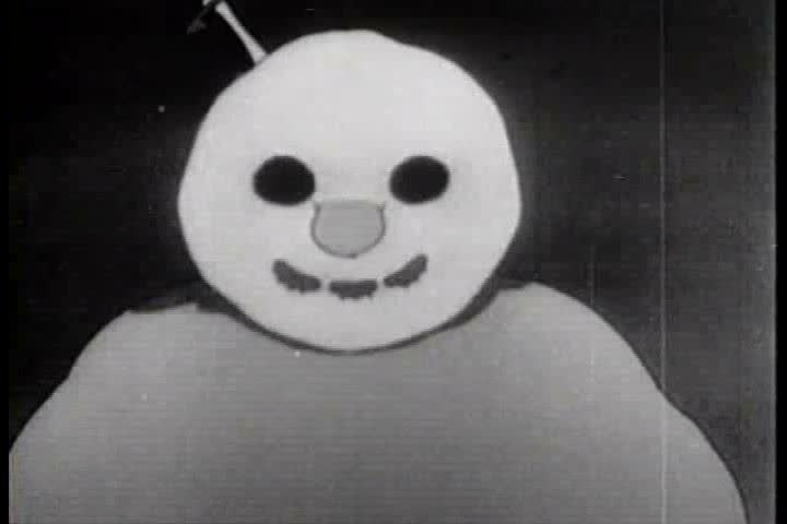 An Eskimo and his animal friends run from the snowman they created, who has inexplicably turned evil, in this cartoon from 1933. He succeeds in catching and eating a fish. (1930s)
