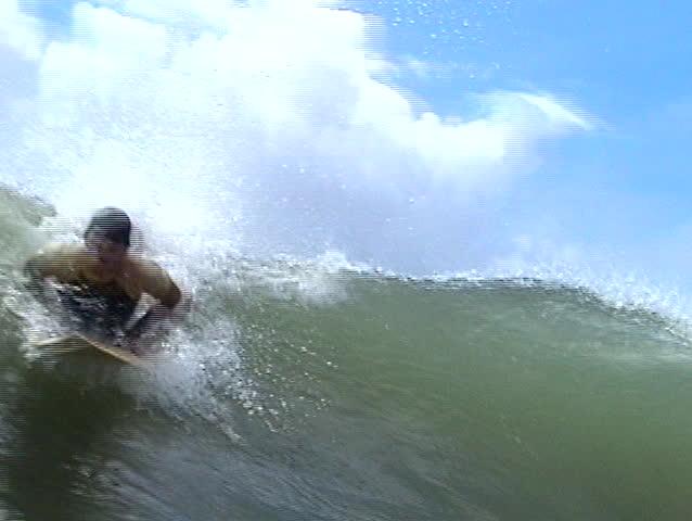 Brazilian surfer. Close-up.