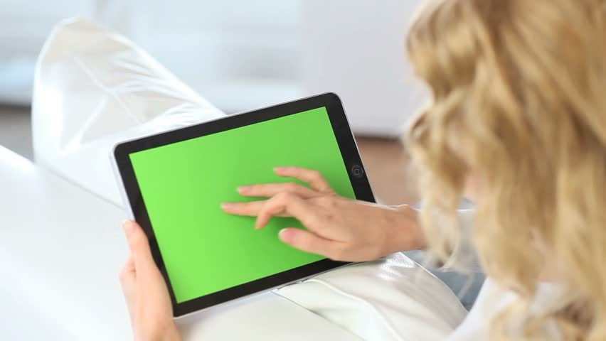 Back view of woman at home using electronic tablet - HD stock video clip