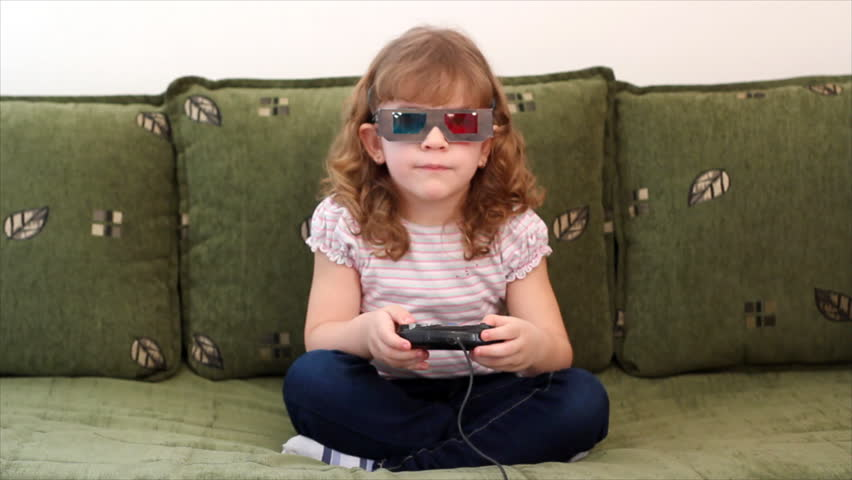 little girl with 3d glasses play video game - HD stock video clip