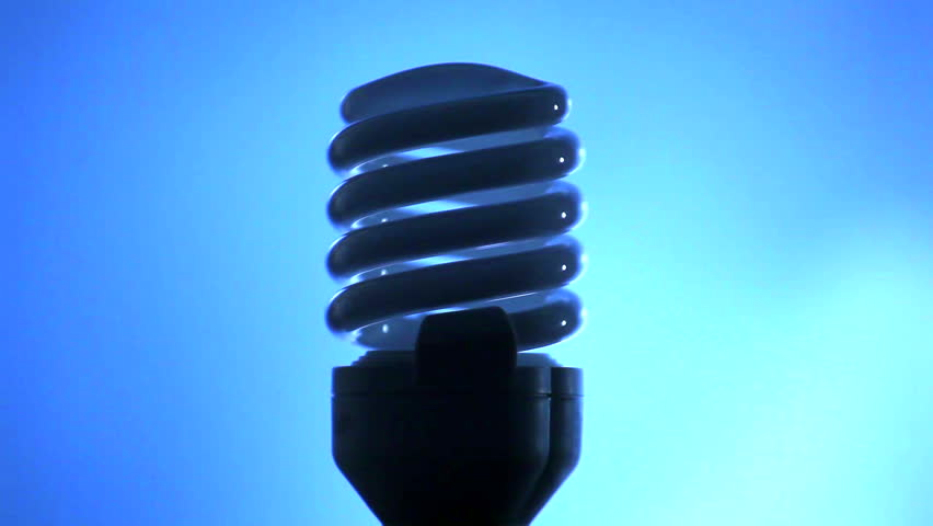 Light of a power saving up modern lamp on a blue background largely - HD stock footage clip