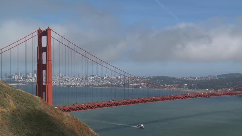 A cargo ship passes under San Francisco's Golden Gate Bridge (timelapse). - HD stock video clip