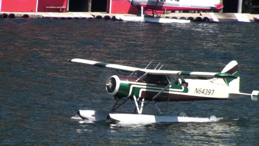 ALASKA, USA - CIRCA 2011; Green float-plane taking off - HD stock footage clip