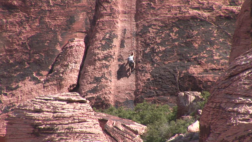 Red Rock Climber zoom   Shutterstock HD Video #2069537