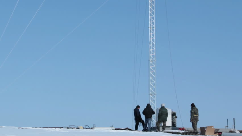 Workers near the cell tower