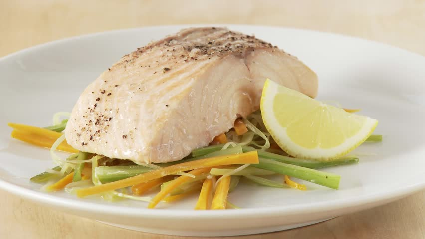 Steamed salmon being served with a foamy sauce - HD stock video clip