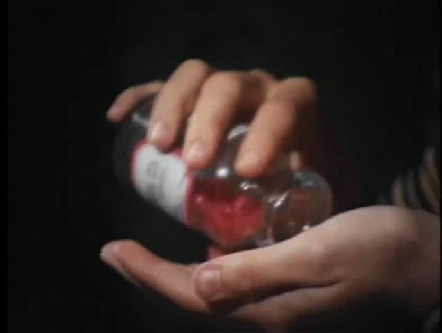 Close-up of female hands pouring pills out of bottle - SD stock footage clip