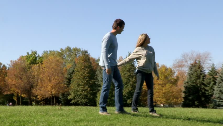 Young happy couple in the park. - HD stock video clip