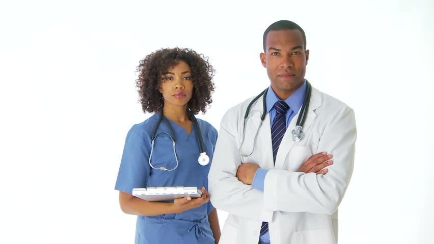 Two African-American doctors standing looking at camera | Shutterstock HD Video #2104160