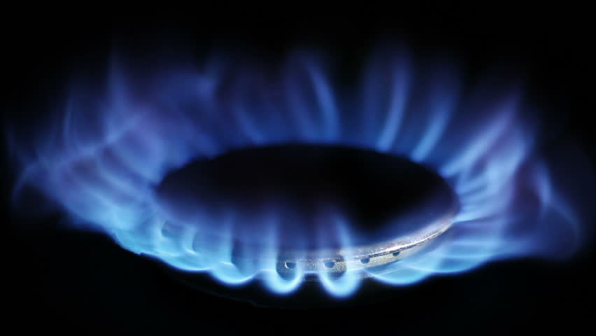 Natural gas inflammation in stove burner, close up view