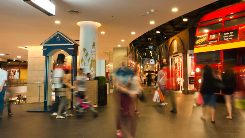 BANGKOK - MARCH 31, 2012: (Panning time-lapse) People take photos in Terminal 21, a newly open shopping mall with country theme floors, in Bangkok, Thailand.  - HD stock video clip