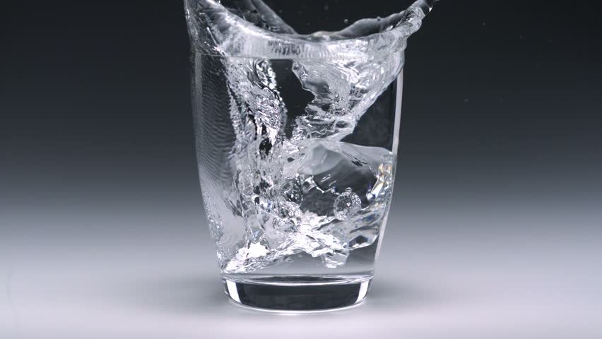 Super slo-mo ice cube falling into glass - HD stock footage clip
