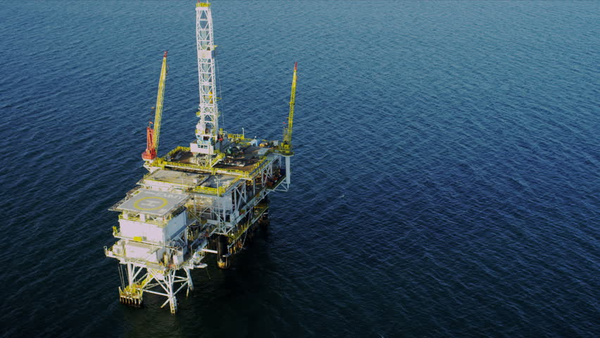 Aerial view of oil producing platform deep ocean, USA - HD stock footage clip