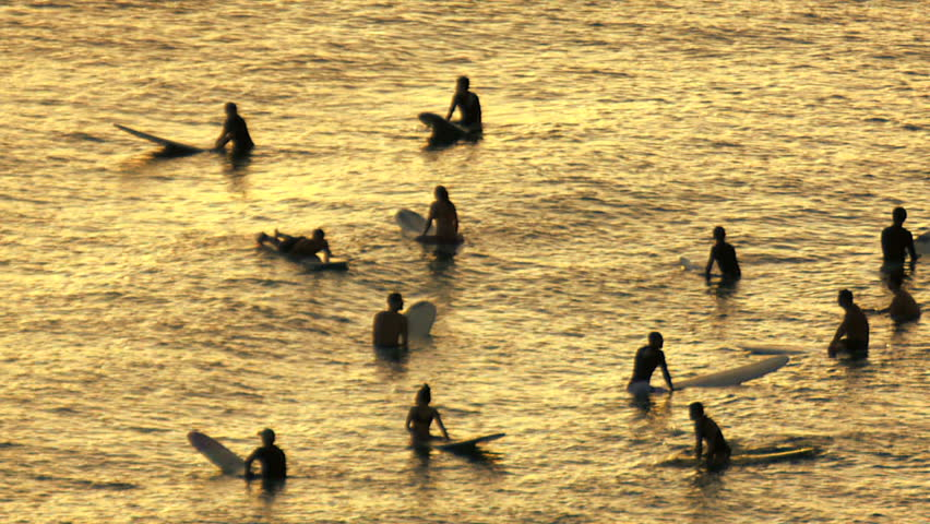 Group surfers in silhouette waiting for waves - HD stock footage clip
