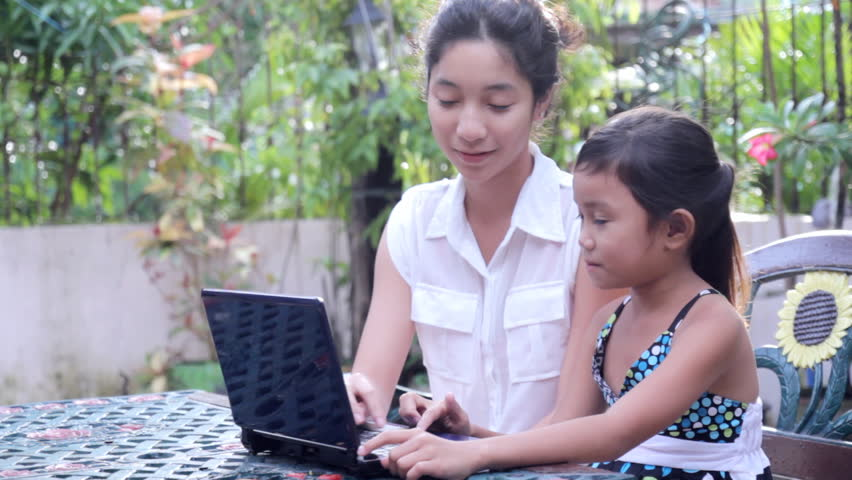children with computer at the garden. - HD stock footage clip
