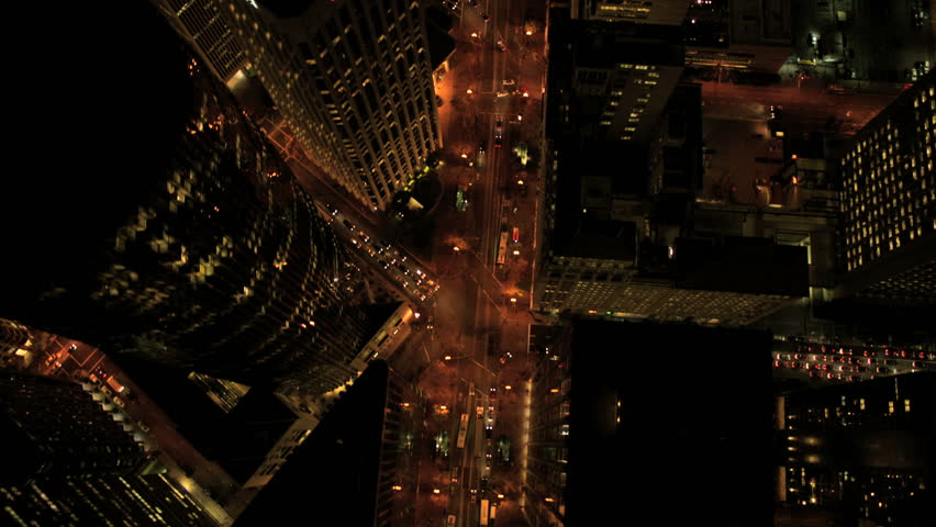Aerial view of city buildings at night in San Francisco