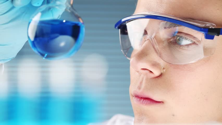 Young scientist doctor in medical laboratory finding a cure  - HD stock footage clip