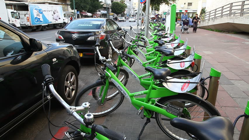 TEL AVIV, ISRAEL - MARCH 26: New public bicycle rental project is on the way in Ben Yehuda Street in Tel Aviv, Israel, March 26, 2012 - HD stock video clip