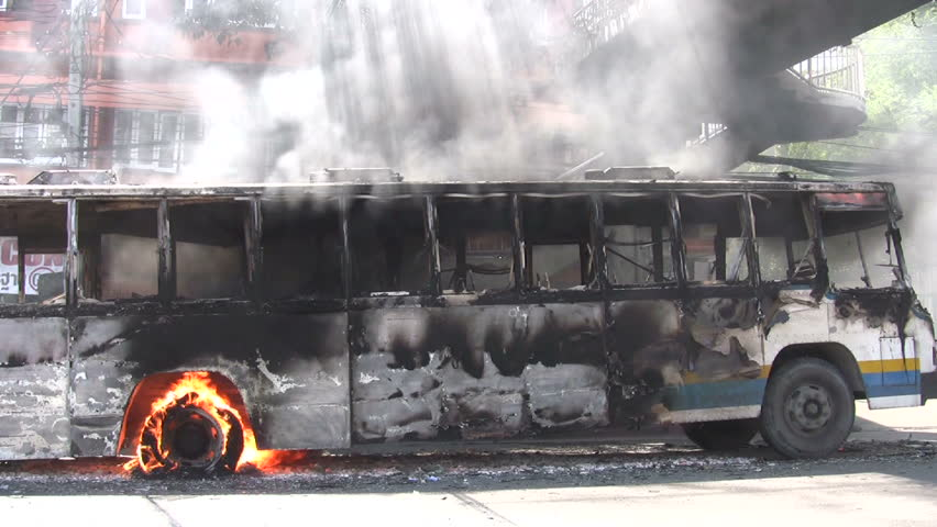 Protesters set buses on fire in violent confrontations with government forces April 5, 2009 in Bangkok, Thailand - HD stock video clip